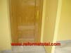 tabiques-puerta-de-madera-suelo-marmol