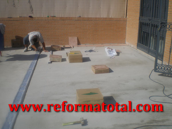 055 07 imagenes suelos hormigon patio fotos de reformas for Solados de hormigon
